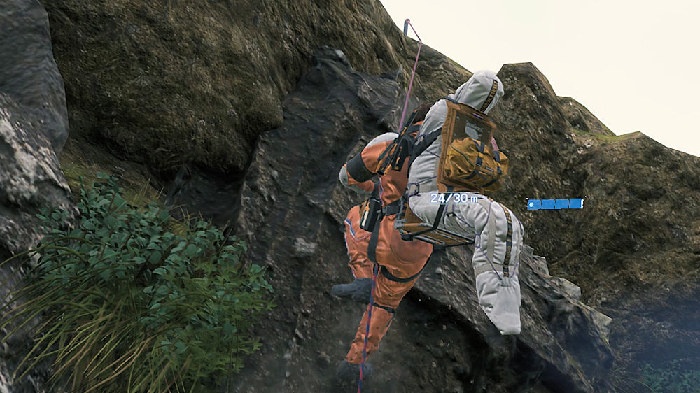 遺体を背負ったまま崖を登る「サム」 - Death Stranding